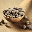 Allspice in spoon - Stock Photo