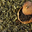 Pu-erh tea aged in tangerine and green tea — Stock Photo