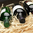 Photo: Wine bottles in straw