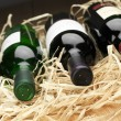 Stock Photo: Wine bottles in straw