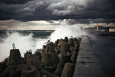 Breakwater at storm — Stock Photo
