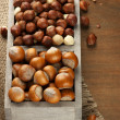 Hazelnuts in wooden box — ストック写真