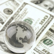 Globe on dollars pile — Stock Photo