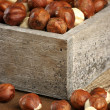 Hazelnuts in wooden box — Stock Photo #38758989