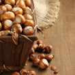 Hazelnuts in basket — Stock Photo
