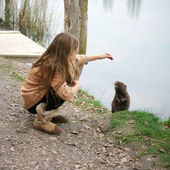 Girl with nutria — Stock Photo