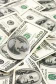 Globe on dollars pile — Stock Photo