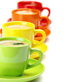 Colorful cups of coffee — Stock Photo