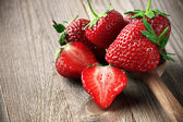 Strawberries on weathered wood — Stock Photo