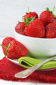 Strawberries in bowl — Stockfoto