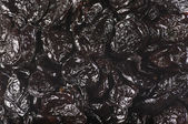 Dried prunes close-up — Stock Photo