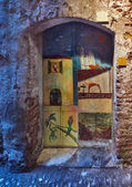 Painted door in Albenga, Liguria, Italy — Stock Photo