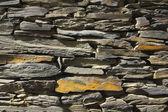 Stone wall. made of slate stone — Stock Photo