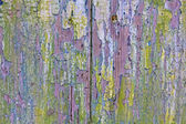 Abstract painting in a damaged door. — Stock Photo