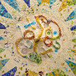 Ceiling with mosaic sun of Park Guell - Stockfoto