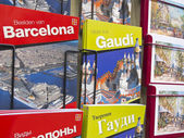 Souvenir shop with city guides and architect Gaudi — Stock Photo