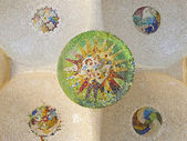 Ceiling with mosaic sun of Park Guell — Stock Photo