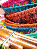 Andean flutes and baskets. — Stock Photo
