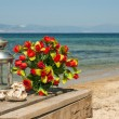 Wedding bouquet of roses on beach — Stock Photo #12704030