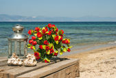 Wedding bouquet of roses on the beach — Stock Photo