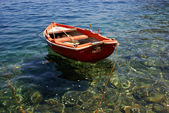 Traditional small boat near the coast — Stock Photo