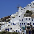 Traditional Greek architecture of Oia village on Santorini islan - Stock Photo