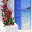 Traditional greek door with a great view on Santorini island, Greece — Stock Photo #13240466
