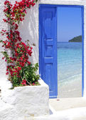 Traditional greek door with a great view on Santorini island, Greece — Stock Photo
