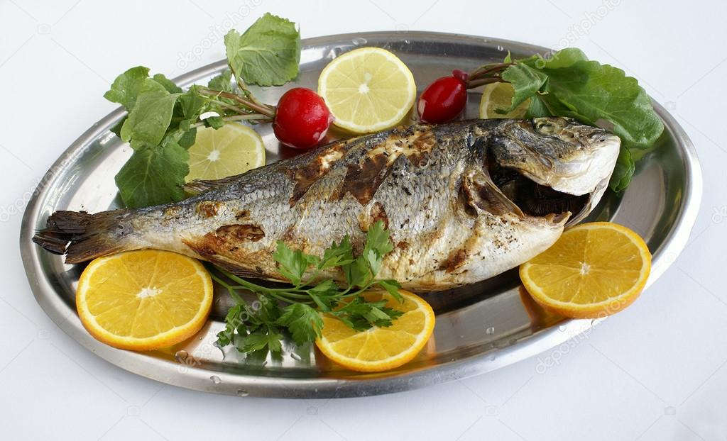 Grill cooked fish with lemon slices and parsley stock for Cooking temp for fish