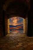 Sunset through the old castle — Stock Photo