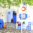 Traditional Greek tavern, on Santorini island, Greece — Stock Photo #22283311