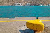 Yellow metal mooring at harbor on Sifnos island, Greece — Stock Photo