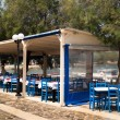 Traditional Greek tavern on Milos island, Greece — Stock Photo #27722903