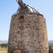 Stock Photo: Traditional old windmill located at Naxos island, Greece