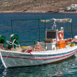 Traditional fishing boat on Mykonos island Greece — Stock Photo #27931955
