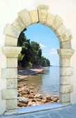 Beautiful beach through the old castle in Greece — Stock Photo
