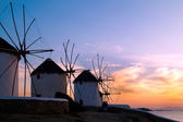 Sunset with famous windmills on Mykonos island, Greece — Stock Photo