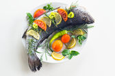 Fresh milokopi with vegetables and lemon — Stock Photo