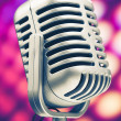 Retro microphone on purple disco background — Stok fotoğraf