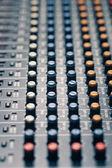 Studio mixer knobs and faders — Stock Photo