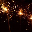 Three christmas sparklers — Stock Photo