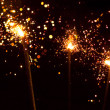 Three christmas sparklers - Stock Photo