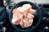 Airbag explodes on steering wheel — Stock Photo