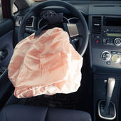 Airbag explodes on steering wheel — Stock fotografie