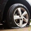 图库照片: Damaged flat tire
