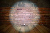 Spotlight on grunge brick wall — Stok fotoğraf