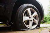 Damaged flat tire — Stock Photo