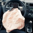 Airbag explodes on steering wheel - Foto Stock