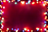 Purple bokeh lights frame — Stock Photo