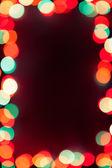 Bokeh ışıklar çerçeve ile koyu arka plan — Stok fotoğraf